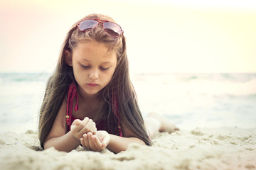 child on a sandy beach