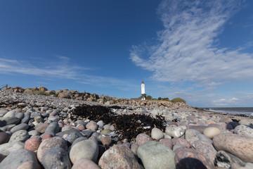 Steine und Leuchtturm