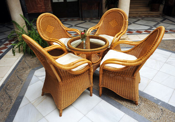 Wicker armchairs inside the house, friendly atmosphere