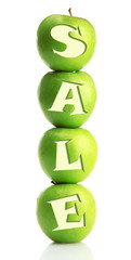Sale concept. Ripe green apples isolated on white