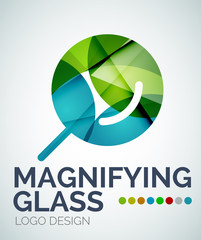 Magnifying glass ogo design made of color pieces