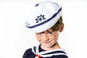 Cute little boy dressed in sailor suit