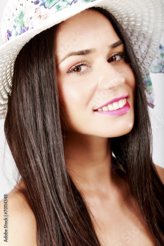 canvas print picture young beautiful caucasian brunette posing on white