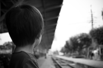 Little boy waiting for a train