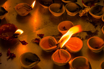 Burning tallow candles in a temple