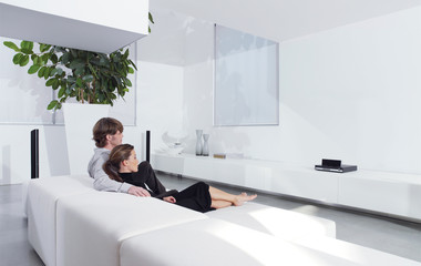 young couple on sofa watching TV