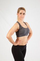 Blond woman in exercise outfit, looking at the camera