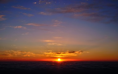 Spectacular panoramic sunrise on the sea of clouds