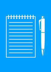 White ballpoint and notepad on blue background