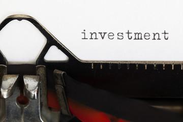 Investment written on old typewriter