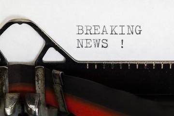 Breaking news written on old typewriter