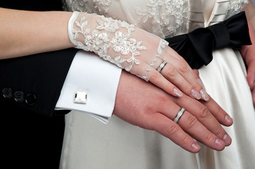 Wedding theme. Just married couple's hands together.
