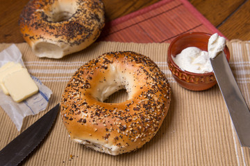 NY  bagels in setting with butter and cream cheese