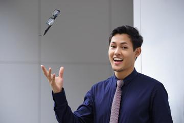 asian business man throwing eyeglasses glasses eyesight