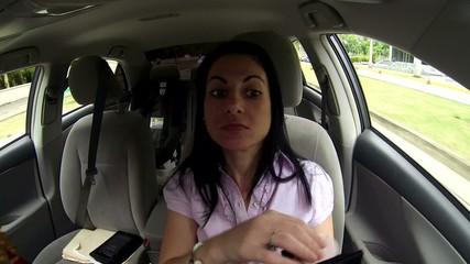beautiful woman in car using make up