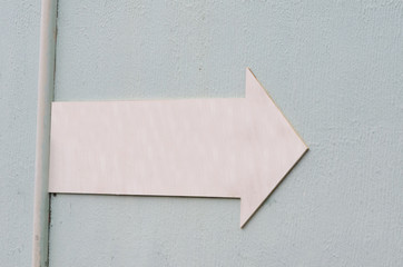 pink elongated arrow, rough bluish background for graphic tube