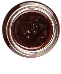 Bottled blueberry jam over white background