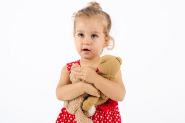 Kind mit zwei Teddys