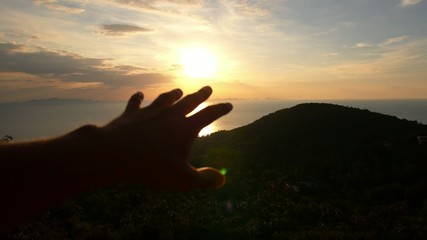 Hand Towards the Sun. Freedom and Happiness at Sunset. Slow