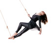 Young woman gymnast on the rope on white background