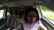 angry young woman screaming in the car