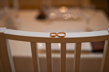 Wedding rings on a chair back 709.
