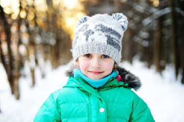 Beauty kid girl on perfect winter day