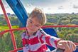 European boy on a Ferris wheel