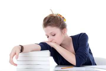 young student sleeping on the books