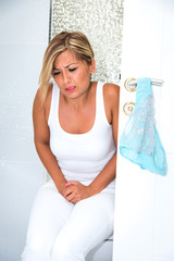 Girl with pain in toilet
