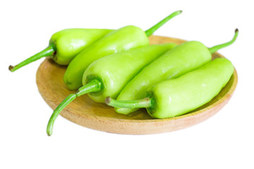 Green pepper chlli on wooden dish