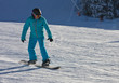 canvas print picture - A man is skiing at a ski resort