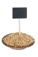 Heap of barley  in a plate, with a pointer for your text