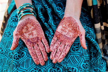 Indian traditional mehndi design on women's hands