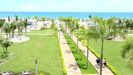 People walking at tropical beach resort