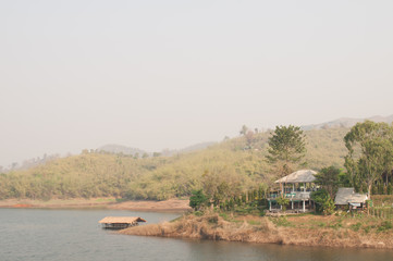 Floating bamboo hut in peaceful lake in Chiang rai, Thailand