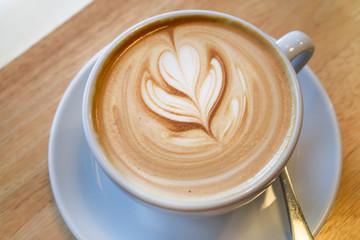 A Latte Coffee art on the wooden desk