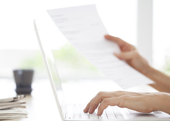Business woman hands typing notes to computer
