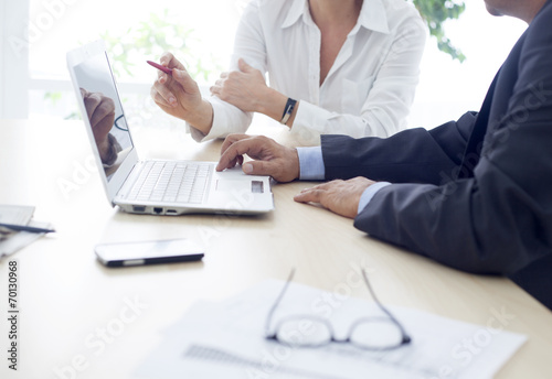 Working man and woman in the office плакат