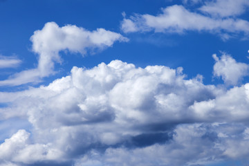 The blue sky with white clouds on the horizon