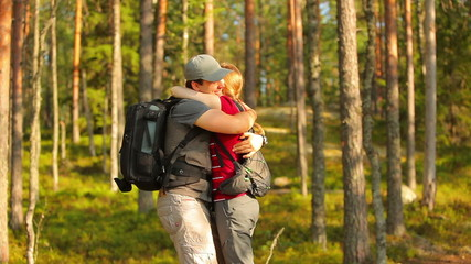 Young tourists couple happy meeting in forest.