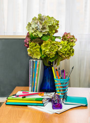 Teacher  Day. Hydrangea flowers and copybooks on the teacher d