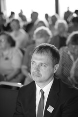 Portrait of a business man in audience, monochrome