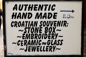 A signboard with a list of Croatian typical souvenir