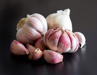 Fresh garlic on a black table