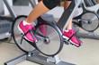 Exercise bike with spinning wheels - woman biking
