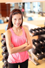 Gym woman in fitness center proud portrait
