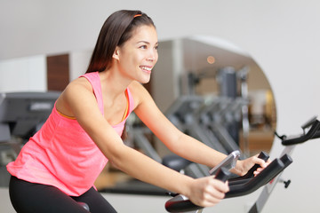 Exercise bike fitness woman excising