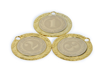 Medals for winners of sporting events isolated on a white backgr