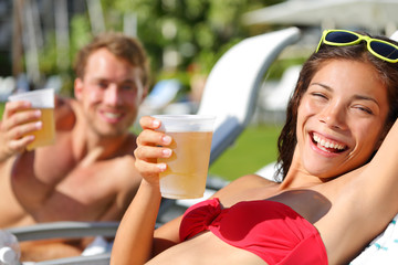 People drinking beer at relaxing at beach resort